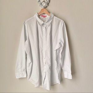 Woman within white button down shirt